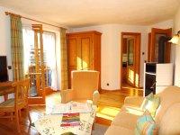 Wohnzimmer mit Kaminofen - Wohnung Nr. 6