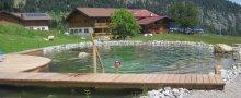 Alpe Dornach Schwimmteich und Ansicht Südseite