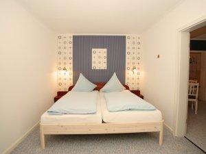 Schlafzimmer - Suite im Inselhotel Arfsten