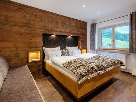 Schlafzimmer mit zusätzlicher Schlafgelegenheit