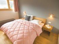 Bergzeit Ferienwohnungen Oberstdorf Schlafzimmer B2