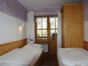 Zweites Schlafzimmer mit getrennten Betten