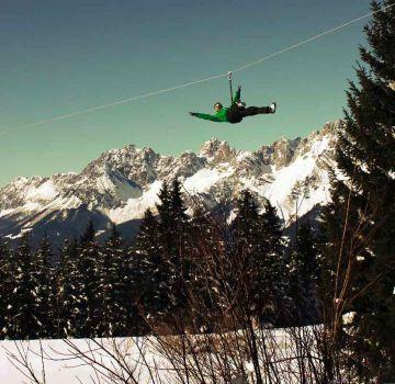 Flying Fox im Hornpark mit Wildem Kaiser im Hintergrund