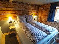 Schlafzimmer Ferienwohnung Lexar Hüs Oberstdorf