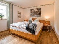 Schlafzimmer in der Ferienwohnung Grün