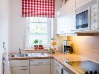 Küche in der Ferienwohnung Rot