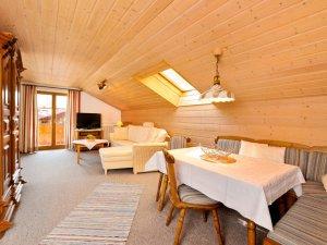 Ferienwohnug Süd - Wohnzimmer mit Essecke