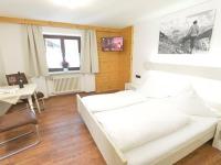 Wohnung 4 Schlafbereich und Sitzecke