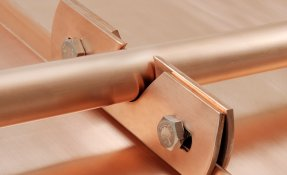 Snow retention clamp in copper for metal roofs