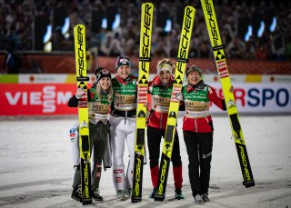 World Champion Team Austria celebrates during the flower ceremony after the Ski Jumping Women Normal Hill Team