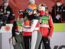 Team Austria reacts during the Ski Jumping Women Normal Hill Team