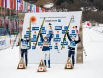 World champion Therese JOHAUG (NOR, center), 2nd Frida KARLSSON (SWE left), 3rd Ebba ANDERSSON (SWE) celebrate during the w