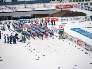 Athletes perform in the Cross Country Men 15.0km Classic + 15.0km Free Skiathlon
