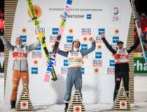 World champion Piotr Zyla (POL, center), 2nd Rank Karl Geiger (GER, left), 3rd Rank Anze Lanisek (SLO) during the winners p