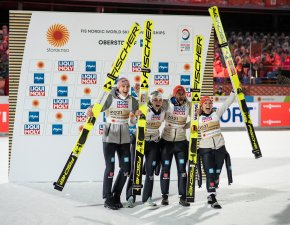 Team Germany celebrates during the winners presentation after the Ski Jumping Mixed Normal Hill Team final round