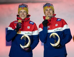 Gold medalists Erik Valnes (r.)and Johannes Hoesflot Klaebo (l.) of Norway pose during the medal ceremony of the Cross Country M