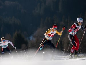 Aktio Watabe (JPN, right) and Terence Weber (GER, center) compete in the Men Nordic Combined Team Gundersen NH:4x5km compet