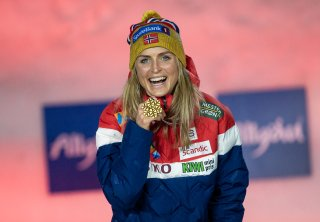 Gold medalist Therese Johaug of Norway poses during the medal ceremony of the Cross Country Women 7.5km Classic + 7.5km Free Ski