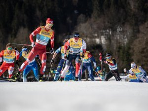 Johannes Hoesflot KLAEBO (NOR, r.) and Gleb RETIVYKH (RSF) compete in the Cross Country Men Team Sprint