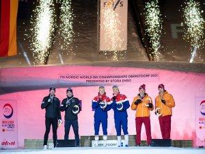 2nd R. Hakola and J. Maki (FIN,l.), World Champion E. Valnes and J. H. Klaebo (NOR), 3rd A. Bolshu
