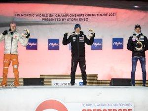 World Champion Piotr Zyla (POL,c.), 2nd Karl Geiger (GER, l.), 3rd Anze Lanisek (NOR,r.)