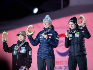 World Champion Maren LUNDBY from Norway, center, second TAKANASHI SaraTAKANASHI from Japan, left, and third Nika KRIZNAR during