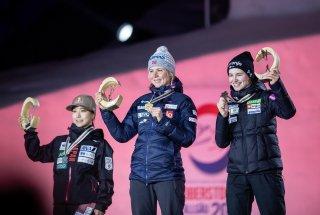 World Champion Maren LUNDBY (NOR, c.), 2nd Sara TAKANASHI (JPN, l.), 3rd Nika KRIZNAR during the medal ceremony