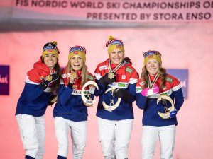 World Champion relay team from Norway poses in the medal ceremony of the Cross Country Women's Relay 4x5.0 km