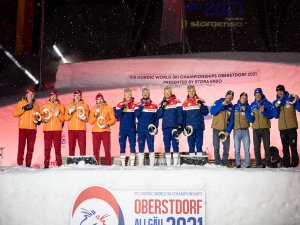 2nd Team Russia (l.), World Champion Team Norway and 3rd Team France pose during the medal ceremony of the Cross Country Men Rel