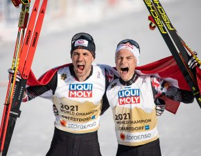 Lukas Greiderer (AUT) and Johannes Lamparter (AUT) celebrate during the Cross Country Men Nordic Combined Team Sprint