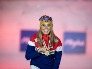 Gold medal winner Therese Johaug poses during the medal ceremony of the Cross Country Women 30.0 km Mass Start Classic