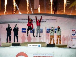 Silver medal winners Espen Andersen and Jarl Magnus Riiber (Norway) (L-R), gold medal winners Johannes Lamparter and Lukas Greid