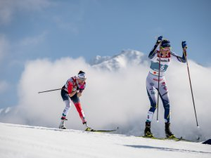 Frida Karlsson (SWE,r.) and Heidi Weng (NOR) compete during the Cross Country Women 30KM Mass Start Classic