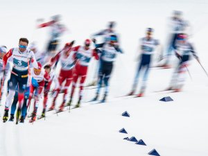 Emil Iversen of Norway (front) leads a field during the Cross Country Men 50.0 km Mass Start Classic