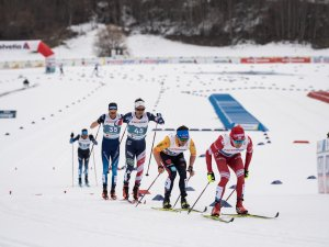 Illia Semikov of Russia (R) and Jonas Dobler of Germany compete during the Cross Country Men 50.0 km Mass Start Classic