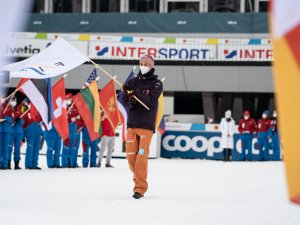 Karl Geiger (GER) carries the FIS flag during the closing ceremony