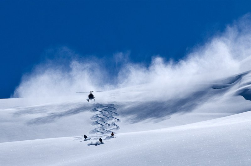 Heli Cloud and Skiers photo Eric Berger
