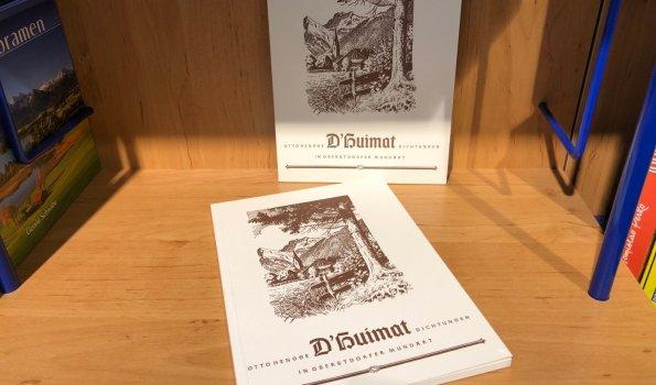 D'Huimat im Bücherregal