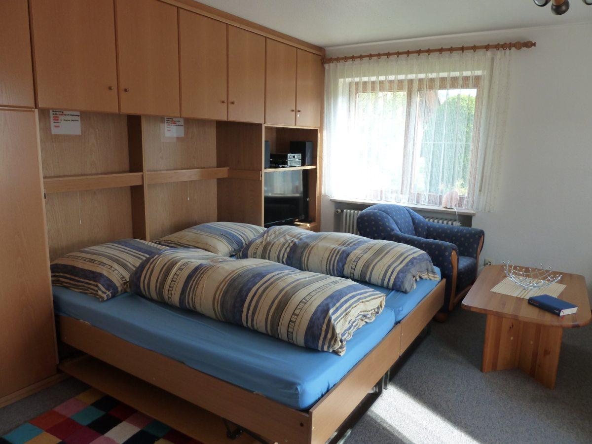 Schrankbett im Wohnzimmer